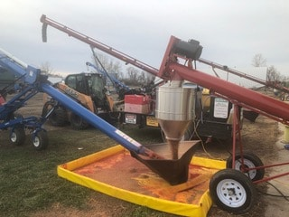 Auger loading treated seed
