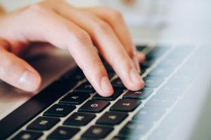 Typing at a laptop