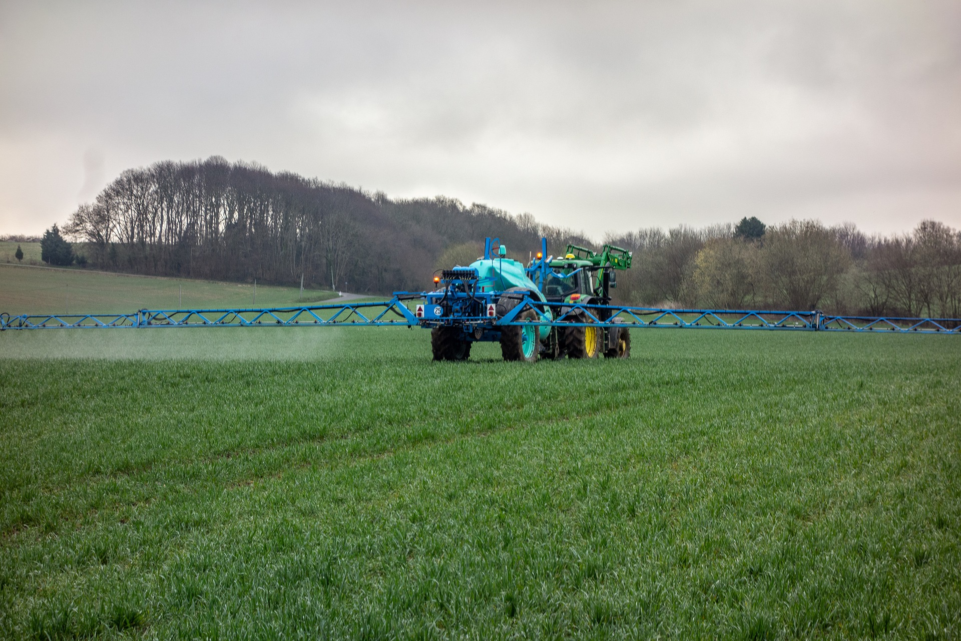 Farmer spraying a field